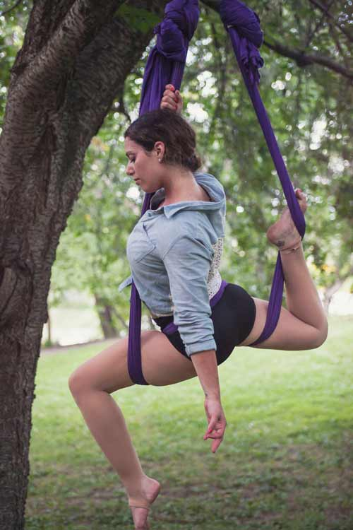 Jodi Kobrin in aerial yoga swing