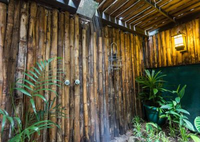 Enjoy a hot shower in our luscious outdoor jungle showers at Danyasa