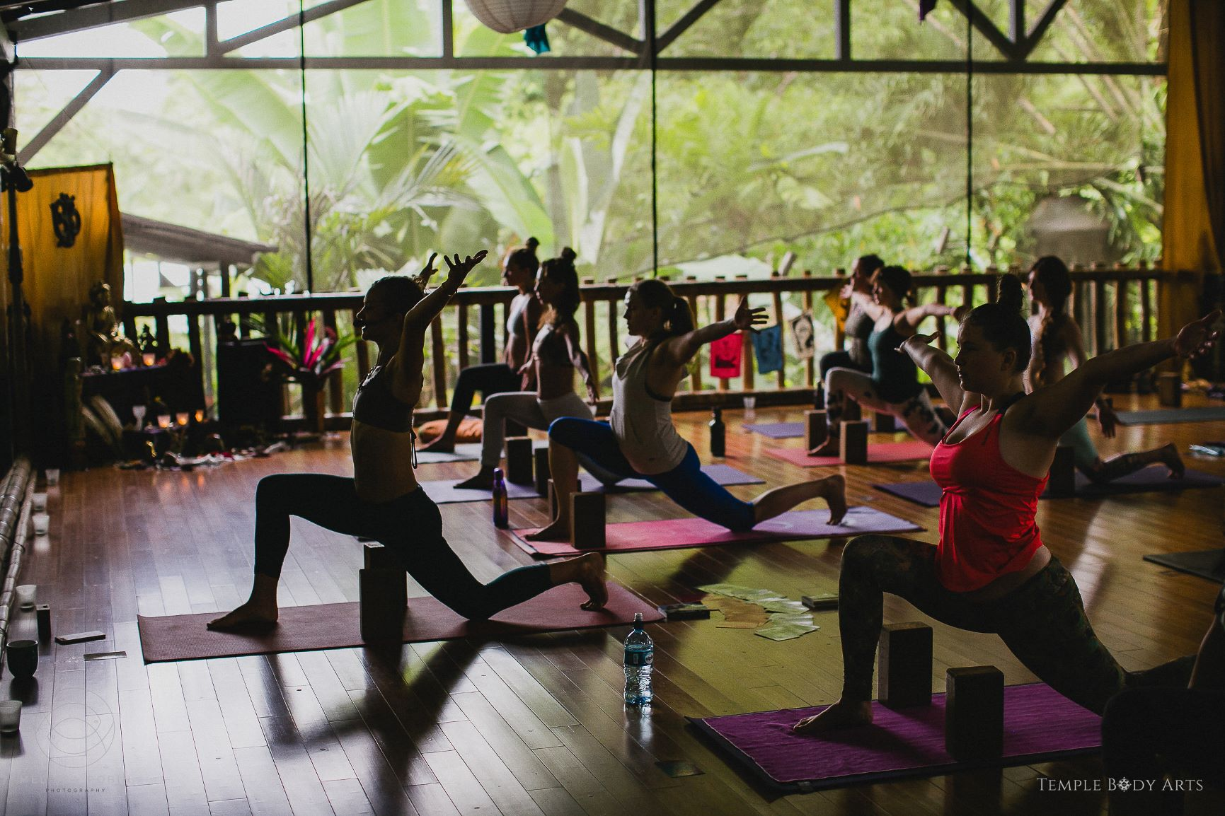 Yoga studio full of students sitting in a circle at Danyasa studio in Costa Rica